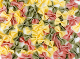 Multicolored Farfalle Pasta on White Background