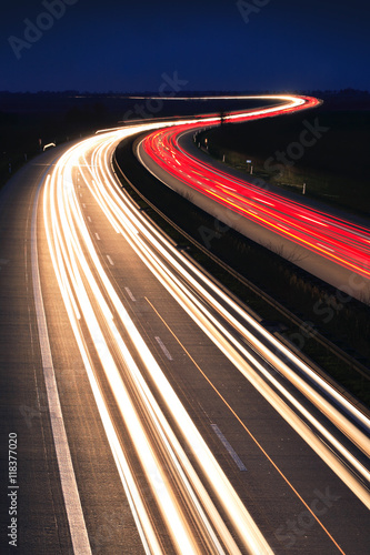 Plagát Winding Motorway at night, long exposure of headlights and taillights in blurred