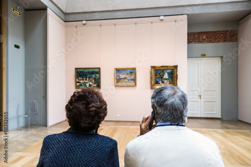 Poster visitors in the Museum with audio guide
