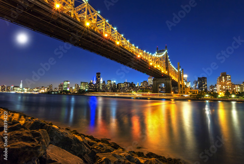 Queensboro Bridge over New York City East River with full moon Poster