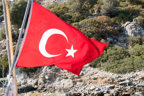 Turkish flag on the rock mountain island background Poster