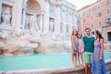 Family near Fontana di Trevi, Rome, Italy. Happy parents and kids enjoy italian vacation holiday in Europe.