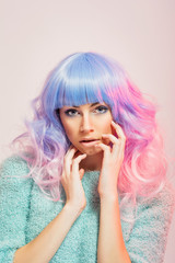 Gorgeous young woman with pastel blue and pink hair