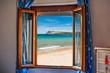 beach seen through an open window - 118409419