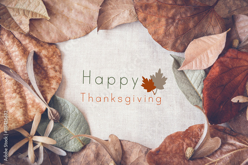 Happy thanksgiving on Autumn leaves toning background