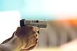hand aim pistol in academy shooting range