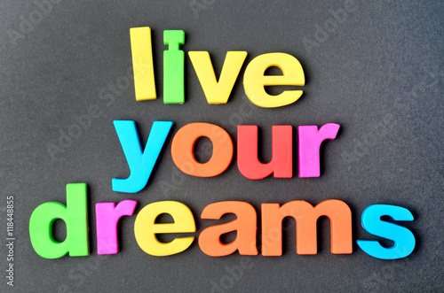 Live your dreams on black background Poster