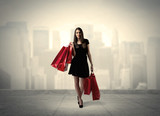 Elegant city girl with red shopping bags