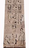 Hieroglyph script on ancient egyptian obelisk in the center of Piazza del Popolo square, Rome