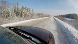 Car Ride on a road along the deep winter forest. FPV view.