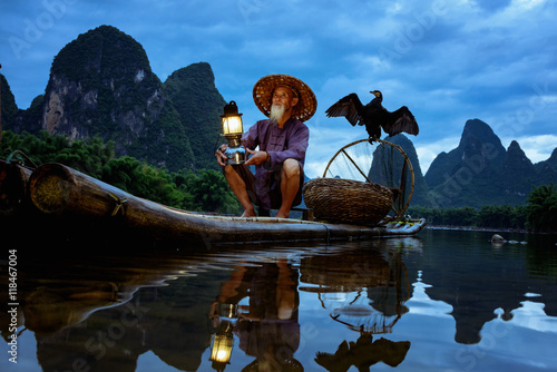Plexiglas Guilin Fisherman of Guilin, Li River and Karst mountains during the blue hour of dawn,Guangxi China