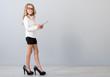 Girl wear high heels of her mother