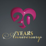 Gold 20 years anniversary red heart black background