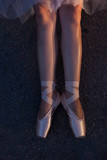 the feet of dancers wearing Pointe Shoes