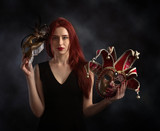 Beautiful redheaded woman with carnival mask