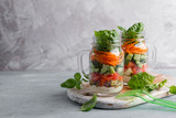Healthy homemade mason jar salad with chicken and vegetables