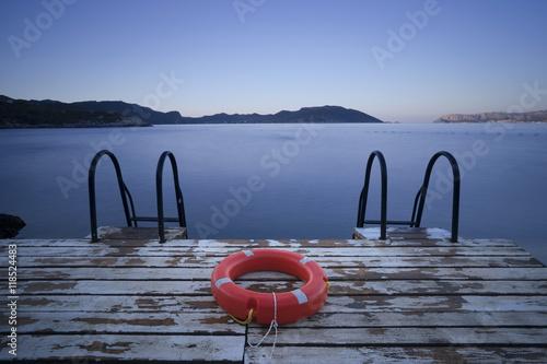 Zdjęcia na płótnie, fototapety, obrazy : Lifebuoy. Steps to the Sea. Kas, Turkey. Kastellorizo and Lighthouse