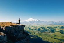 Traveler looking to Elbrus mountain