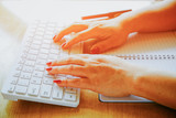Close up of hands typing on computer keyboard
