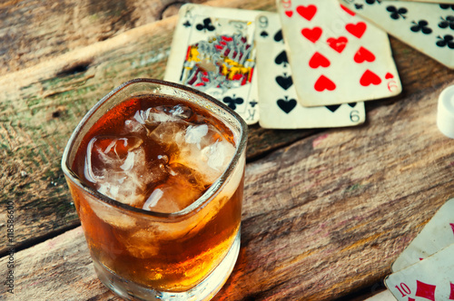 Whiskey, cigar and cards on a wooden background плакат