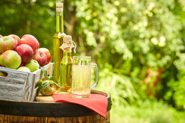 Apple cider at the barrel outdoor shot on garden background