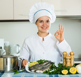 Professional chef cooking fresh trout at kitchen