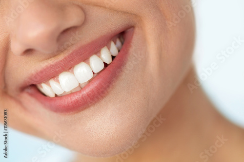 Closeup Of Beautiful Smile With White Teeth. Woman Mouth Smiling. High Resolution Image © puhhha