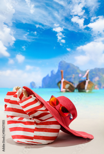 Summer beach bag with red  straw hat and sunglasses © Netfalls