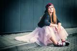 Trendy beautiful long haired girl posing, hip hop fashion - 118689686