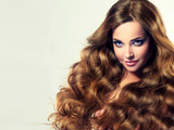 Beautiful girl  light brown hair with an elegant curly hairstyle