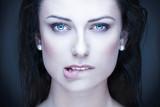 Sexy brunette woman bite lips portrait