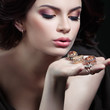 Cute girl holds in the palm of gold and silver rings