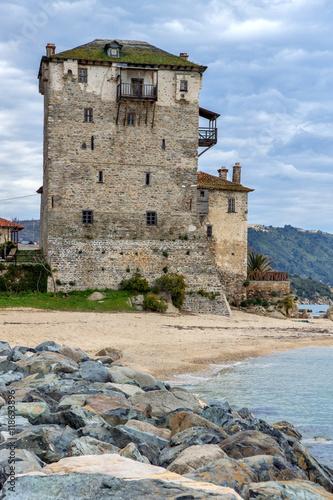 Zdjęcia na płótnie, fototapety, obrazy : Seascape with Stones Medieval tower in  Ouranopoli, Athos, Chalkidiki, Central Macedonia, Greece
