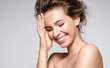 Leinwanddruck Bild - Beautiful smiling woman with natural make-up, clean skin and white teeth on grey background