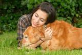 Brunette Woman Praising Her Golden Retriever Dog Canine
