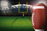 football on field with field goal post