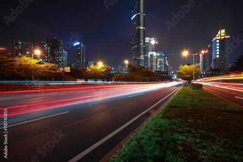 Foto op Aluminium Nacht snelweg Empty road surface floor with modern city landmark architecture