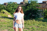 young woman in torn t shirt posing
