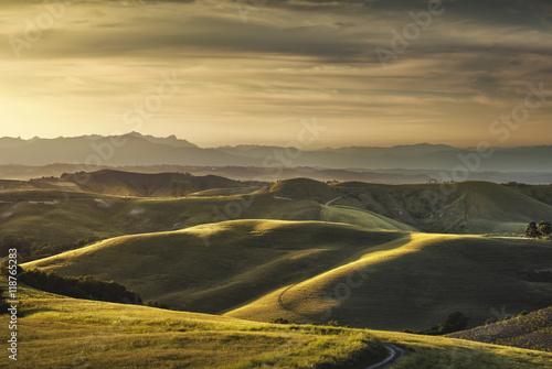 Fototapeta Tuscany spring, rolling hills on sunset. Rural landscape. Green