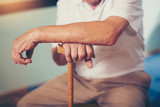 Hand of a senior man holding a stick