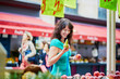 French woman choosing fruits on market