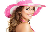 Gorgeous summer style happy blonde young woman in pink and white hat