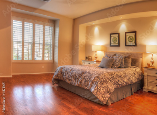 Irvine, CA, USA – August 19, 2016: Large master bedroom with recessed lighting, wood floors and feng shui decor Poster