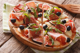 pizza with figs, prosciutto, herbs, olives and mozzarella closeup. Horizontal