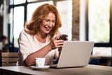 Cute woman using smart phone