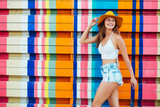 young woman with hat on colorful background - 118795847