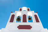 White and red bells tower in Santorini - Greece