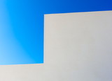 Abstract white wall and blue sky