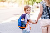 7 years old boy going to school with his mother - 118816497