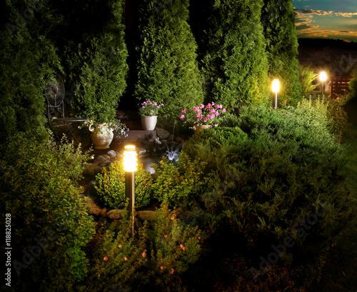 Illuminated home garden patio on evening dusk